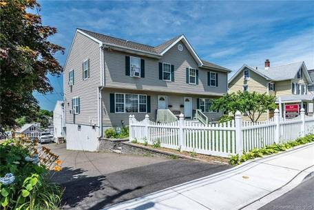 Multi Family Home Sold in Norwalk CT 06854.  house near beach side waterfront with 4 car garage.