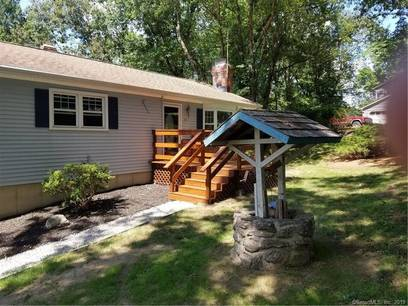 Single Family Home For Sale in Monroe CT 06468. Ranch house near waterfront with swimming pool and 2 car garage.