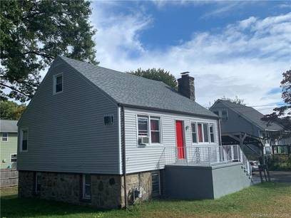 Multi Family Home Sold in Bridgeport CT 06606.  house near waterfront with 2 car garage.
