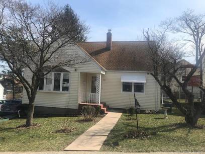 Single Family Home Sold in Bridgeport CT 06606.  cape cod house near waterfront with 1 car garage.