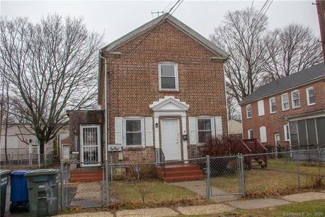 Foreclosure: Multi Family Home Sold in Bridgeport CT 06610. Old  house near waterfront with 1 car garage.