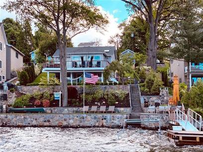 Single Family Home Sold in Brookfield CT 06804.  cottage house near lake side waterfront.