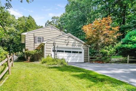Single Family Home For Sale in Westport CT 06880. Colonial house near beach side waterfront with 2 car garage.