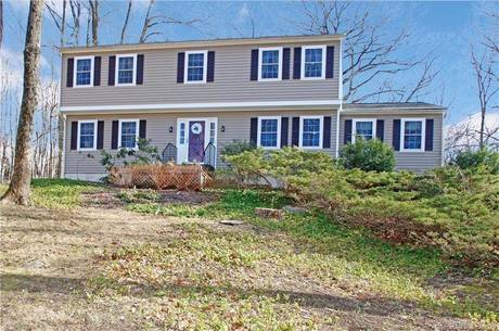 Single Family Home For Sale in Bethel CT 06801. Colonial house near waterfront with 2 car garage.
