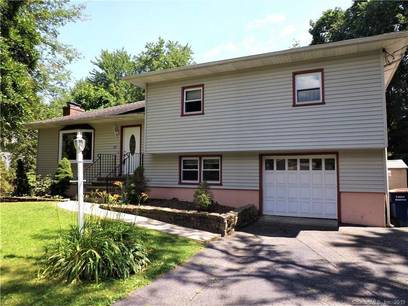 Single Family Home Sold in Trumbull CT 06611.  house near river side waterfront with 1 car garage.