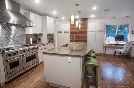 Single Family Home Sold in New Canaan CT 06840. Ranch house near waterfront with 2 car garage.