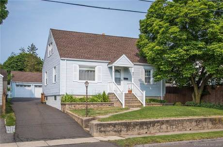 Single Family Home Sold in Stratford CT 06614.  cape cod house near waterfront with swimming pool and 2 car garage.