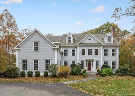 Single Family Home For Sale in Wilton CT 06897. Colonial house near waterfront with 3 car garage.