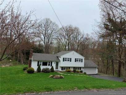 Single Family Home Sold in New Fairfield CT 06812.  house near waterfront with 2 car garage.