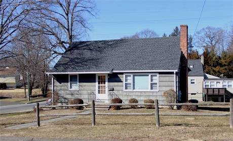 Single Family Home Sold in Norwalk CT 06850.  cape cod house near waterfront with 1 car garage.