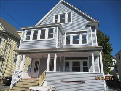 Multi Family Home Sold in Bridgeport CT 06605. Old  house near waterfront with 1 car garage.