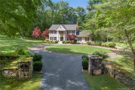 Single Family Home Sold in Ridgefield CT 06877. Colonial house near river side waterfront with 3 car garage.
