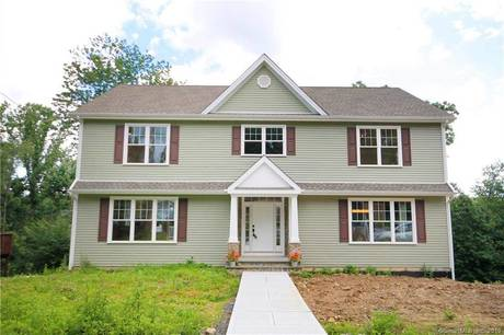 Single Family Home Sold in Brookfield CT 06804. Colonial house near beach side waterfront with 2 car garage.