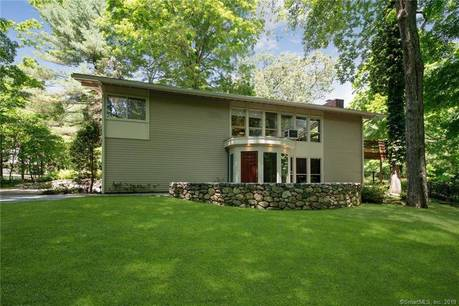 Single Family Home Sold in Stamford CT 06903. Ranch house near river side waterfront with swimming pool and 2 car garage.