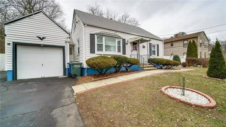 Single Family Home Sold in Bridgeport CT 06610.  cape cod house near waterfront with swimming pool and 1 car garage.