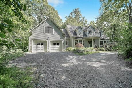 Single Family Home Sold in Ridgefield CT 06877.  cape cod house near lake side waterfront with 2 car garage.