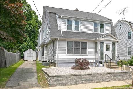 Single Family Home For Sale in Stratford CT 06614. Old colonial house near waterfront.