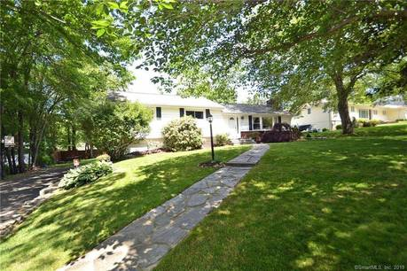 Single Family Home Sold in Fairfield CT 06825. Ranch house near beach side waterfront with swimming pool and 2 car garage.