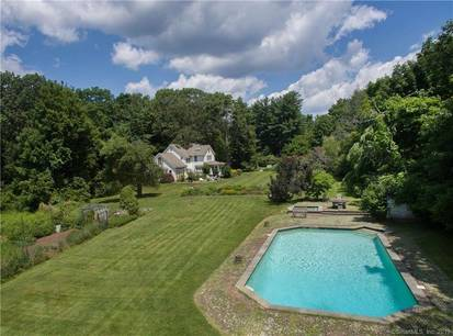 Single Family Home Sold in Ridgefield CT 06877. Old colonial house near waterfront with swimming pool and 1 car garage.