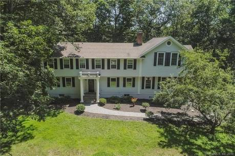 Single Family Home Sold in Wilton CT 06897. Colonial house near waterfront with swimming pool and 2 car garage.