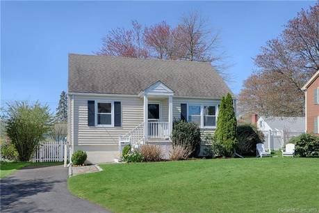 Single Family Home Sold in Fairfield CT 06824.  cape cod house near beach side waterfront.