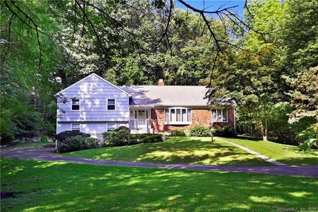 Single Family Home Sold in Greenwich CT 06807.  house near beach side waterfront with 2 car garage.