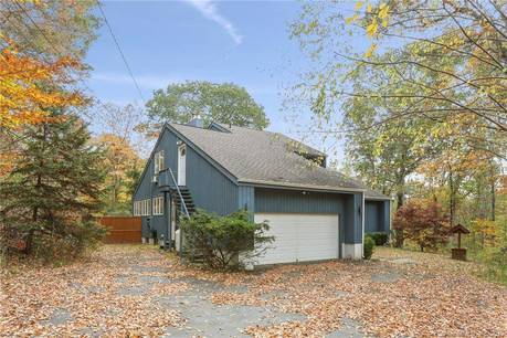 Single Family Home Sold in Newtown CT 06470. Contemporary house near waterfront with 2 car garage.