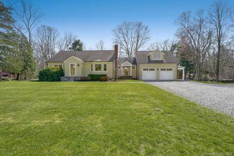 Single Family Home For Sale in Monroe CT 06468.  cape cod house near waterfront with 2 car garage.