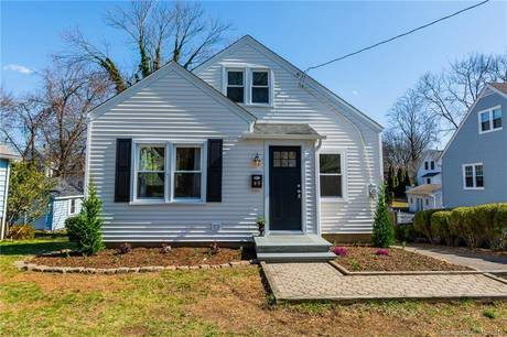 Single Family Home Sold in Fairfield CT 06825.  cape cod house near waterfront.