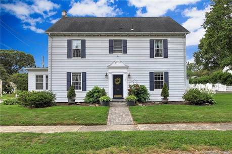 Single Family Home For Sale in Stratford CT 06615. Old colonial house near beach side waterfront with 2 car garage.