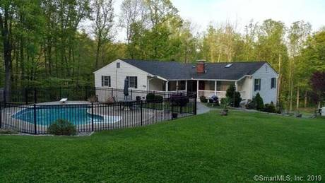 Single Family Home Sold in Ridgefield CT 06877. Ranch house near waterfront with swimming pool and 3 car garage.