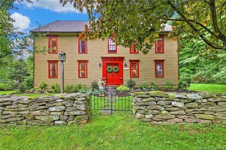 Single Family Home Sold in Trumbull CT 06611. Old colonial saltbox house near waterfront with 2 car garage.