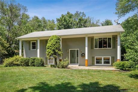 Single Family Home For Sale in Danbury CT 06811. Ranch house near beach side waterfront with 2 car garage.