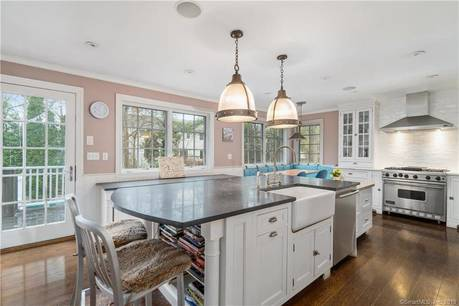 Luxury Single Family Home Sold in Greenwich CT 06870. Colonial house near waterfront with swimming pool and 2 car garage.
