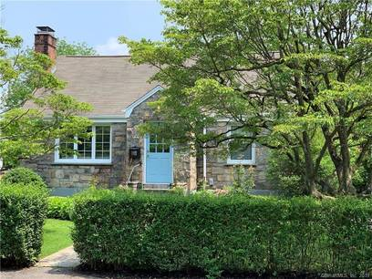 Single Family Home Sold in Greenwich CT 06807.  cape cod house near river side waterfront with 4 car garage.