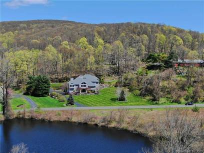 Single Family Home Sold in New Fairfield CT 06812. Contemporary house near waterfront with 3 car garage.