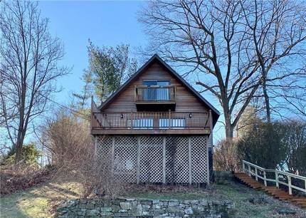 Single Family Home For Rent in Danbury CT 06811. Contemporary chalet house near beach side waterfront.
