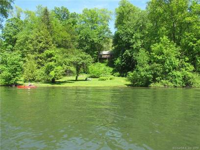 Single Family Home Sold in Sherman CT 06784. Ranch house near lake side waterfront with 2 car garage.