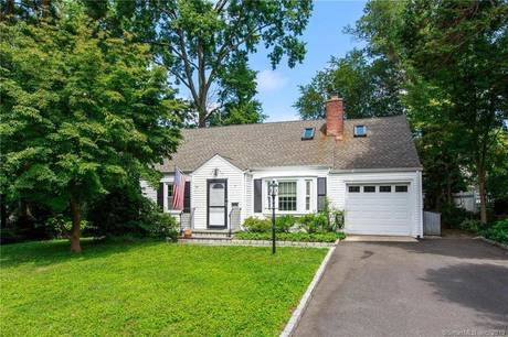 Single Family Home For Sale in Darien CT 06820.  cape cod house near waterfront with 1 car garage.