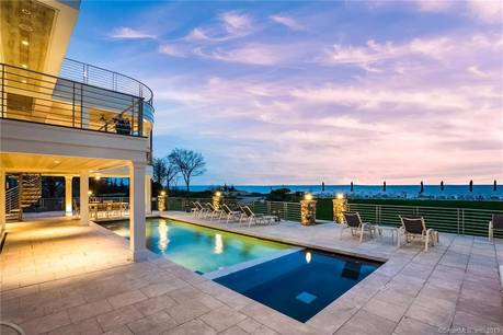 Luxury Single Family Home Sold in Norwalk CT 06853. Contemporary house near beach side waterfront with swimming pool and 2 car garage.