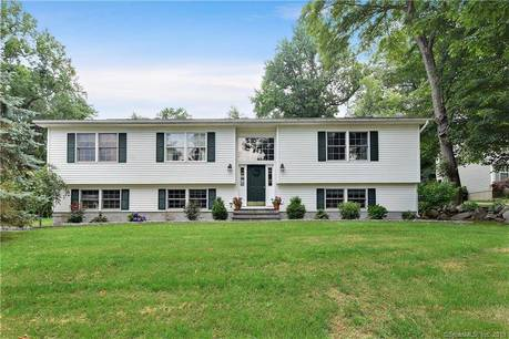 Single Family Home Sold in Danbury CT 06811. Ranch house near beach side waterfront with 1 car garage.