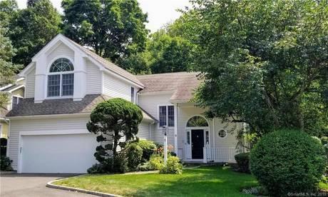 Condo Home Sold in Wilton CT 06897.  house near waterfront with swimming pool and 2 car garage.