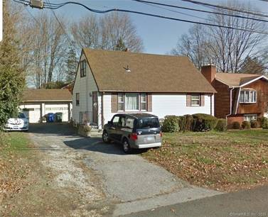 Short Sale: Single Family Home Sold in Bridgeport CT 06606.  cape cod house near waterfront with 2 car garage.