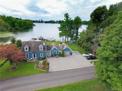 Single Family Home Sold in New Fairfield CT 06812.  cape cod house near waterfront with 1 car garage.