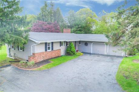Single Family Home Sold in Trumbull CT 06611. Ranch house near waterfront with swimming pool and 2 car garage.