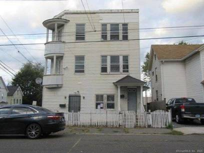 Foreclosure: Multi Family Home Sold in Bridgeport CT 06606. Old  house near waterfront with 1 car garage.