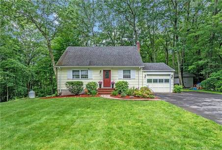 Single Family Home Sold in Fairfield CT 06825.  cape cod house near lake side waterfront with 1 car garage.
