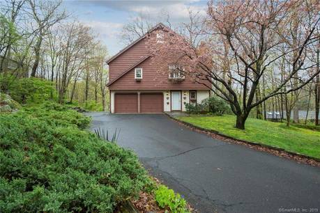 Single Family Home Sold in Ridgefield CT 06877.  cape cod, chalet house near beach side waterfront with 2 car garage.