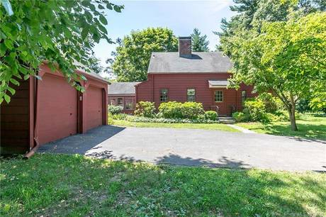 Single Family Home Sold in Stratford CT 06614. Old  cape cod house near beach side waterfront with 2 car garage.