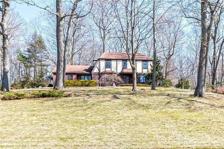 Single Family Home Sold in Shelton CT 06484. Colonial, tudor house near waterfront with 2 car garage.